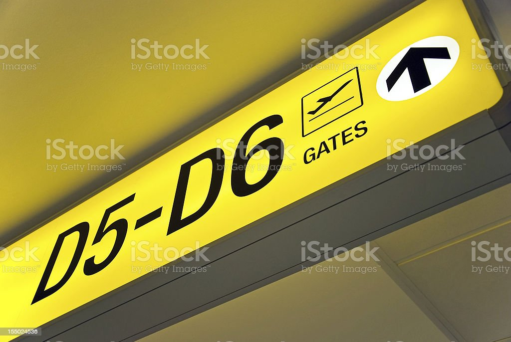 Departure sign showing direction to gates royalty-free stock photo