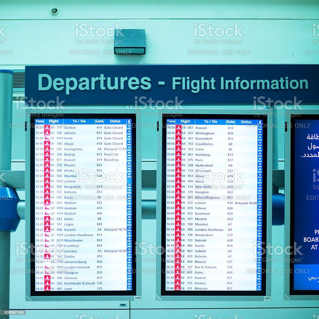 Departure timetables in airport Dubai stock photo