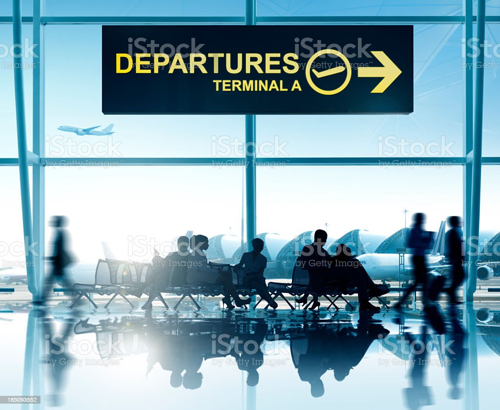 Departures lounge at airport with planes in background stock photo