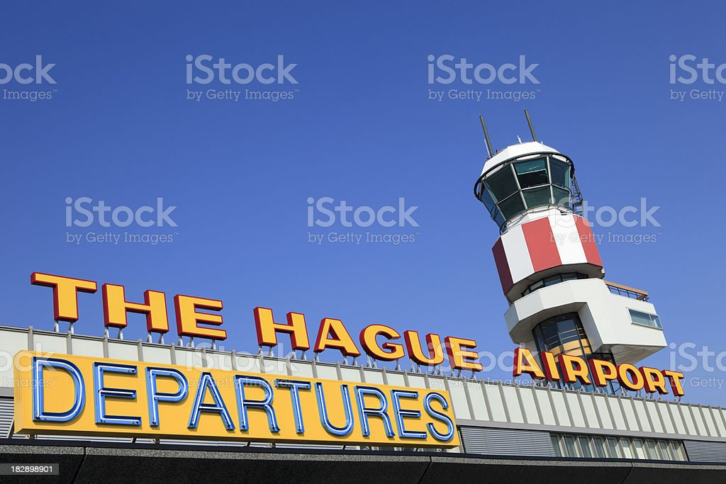 departures sign and flight control tower against a blue sky royalty-free stock photo