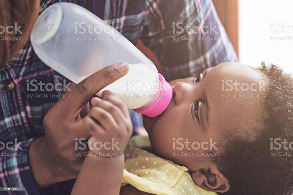 Dependent on her mother's love stock photo