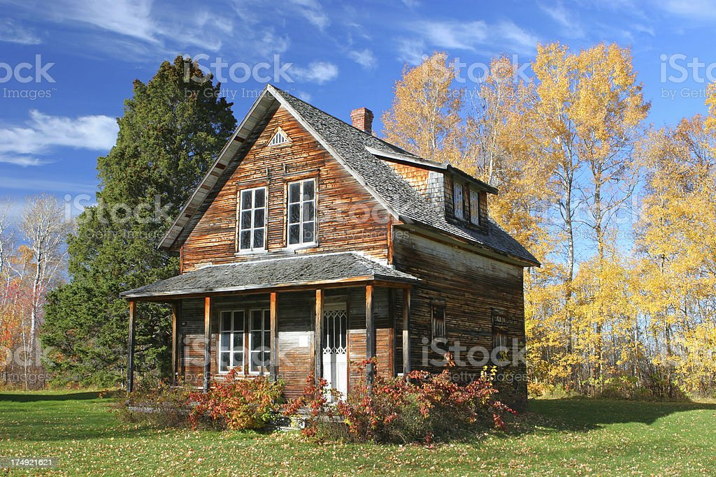 Depleting vintage house in colorful Autumn royalty-free stock photo
