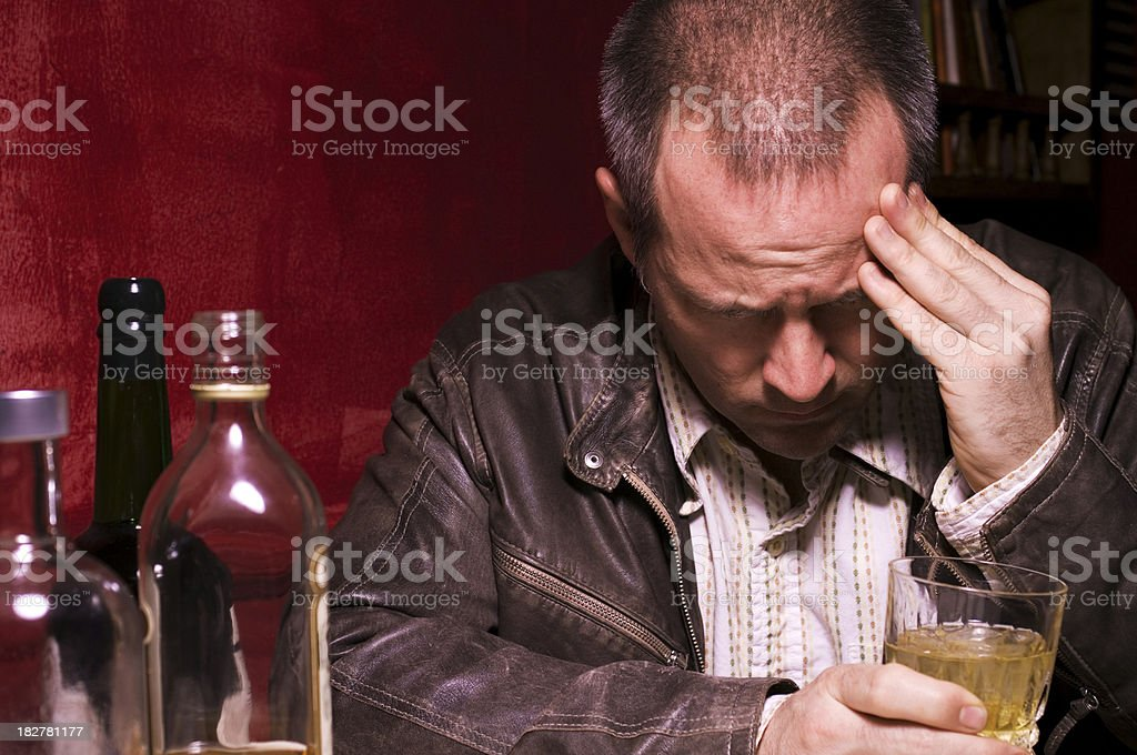 Depressed and Alone Forty Year Old Man Drinking royalty-free stock photo
