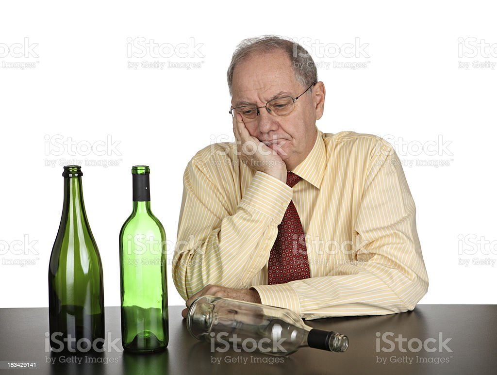Depressed and drunk businessman stock photo