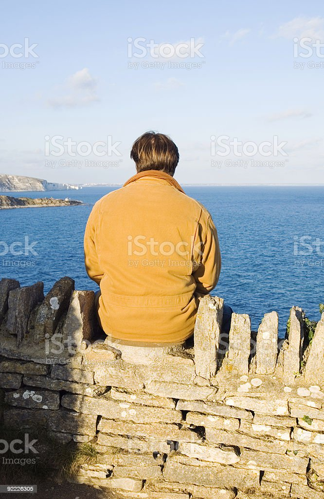 depressed and lonely man looks out at view. stock photo