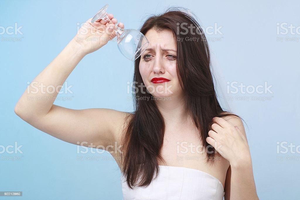Depressed bride with empty glass stock photo