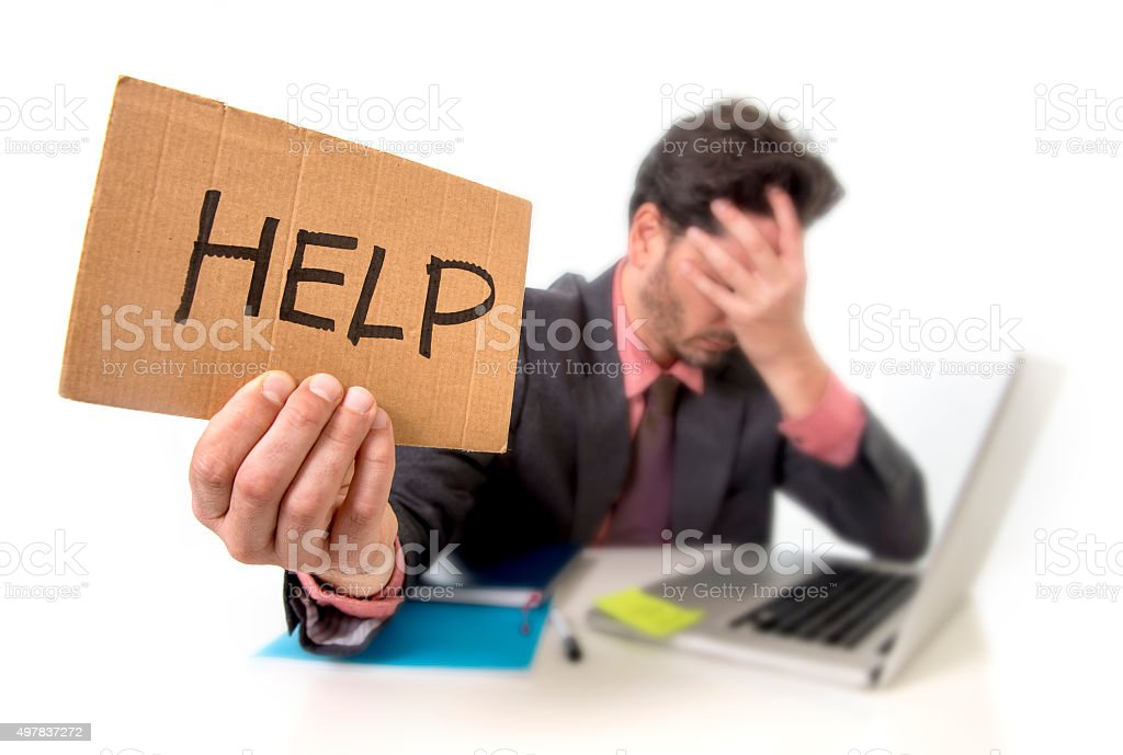 depressed businessman at office working on computer asking for help stock photo