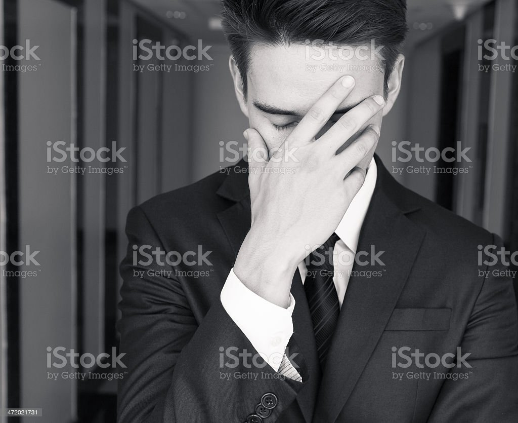 A depressed businessman in black and white stock photo