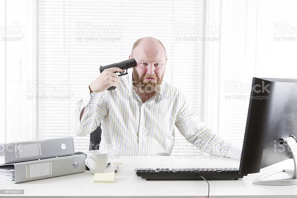 Depressed businessman point a Gun to his Head royalty-free stock photo
