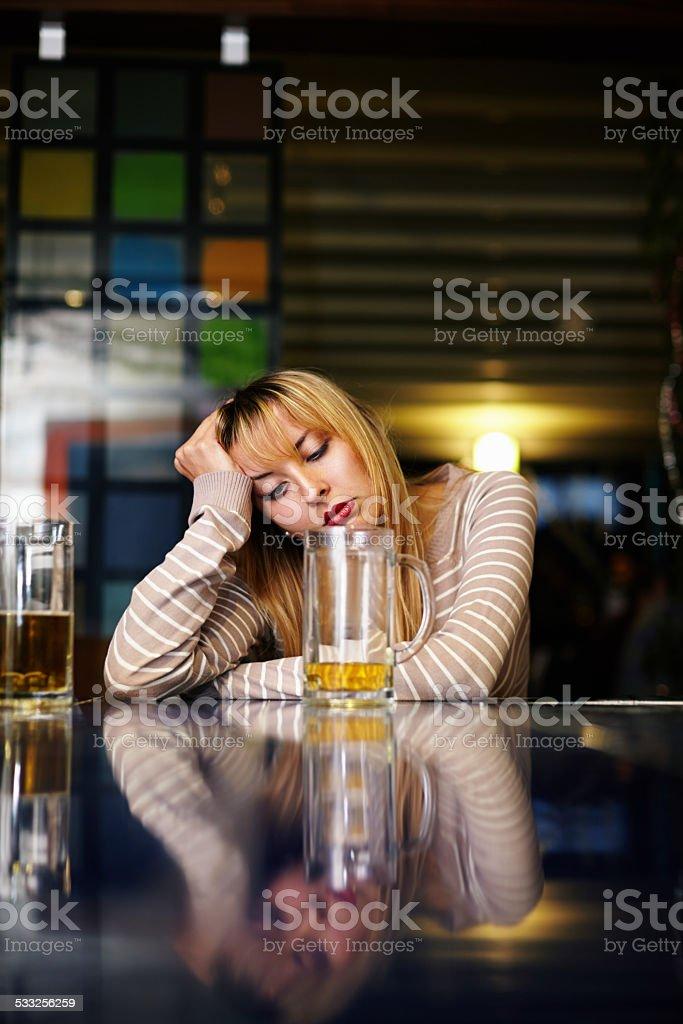 Depressed Drinking Woman stock photo