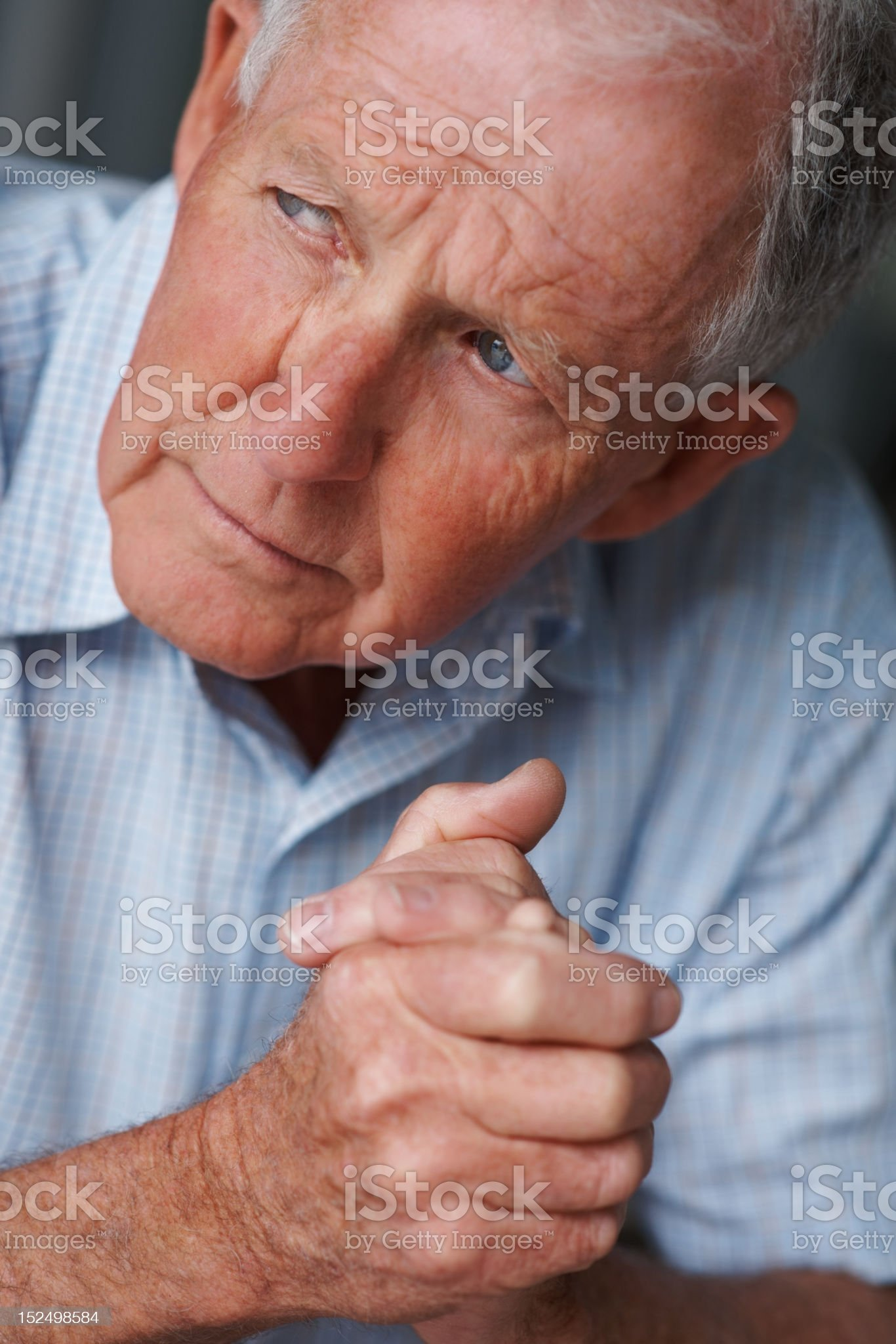 Depressed elderly man lost in thought royalty-free stock photo