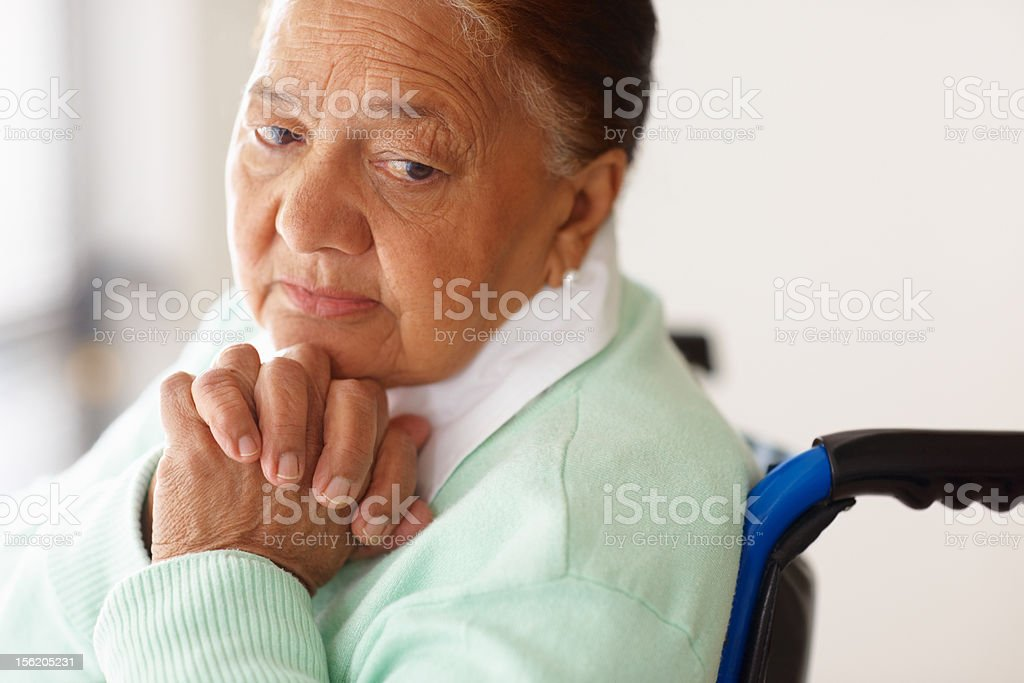 Depressed elderly woman on a wheelchair royalty-free stock photo