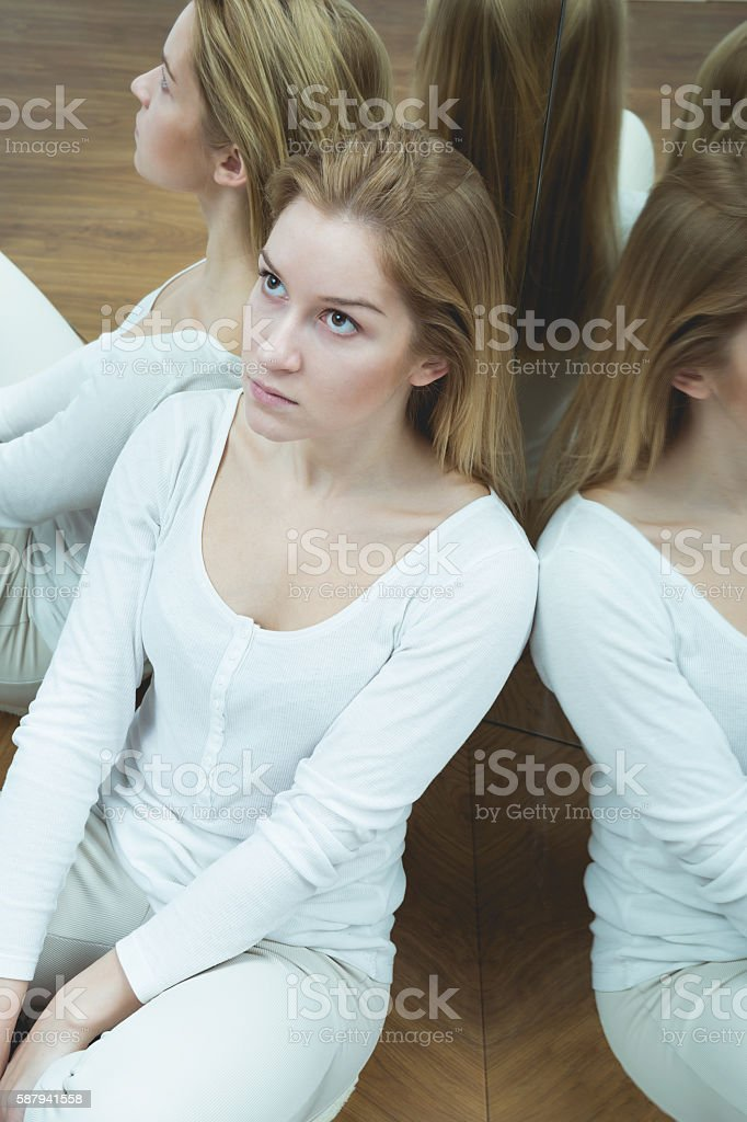 Depressed female with paranoia stock photo