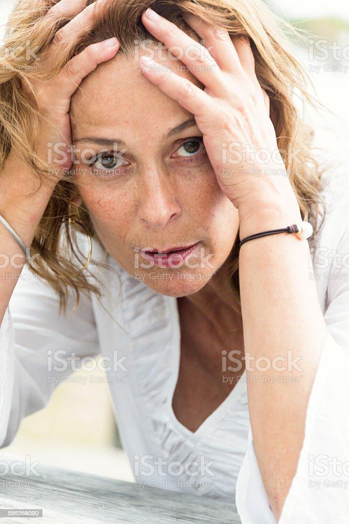 Depressed fifty something woman stock photo