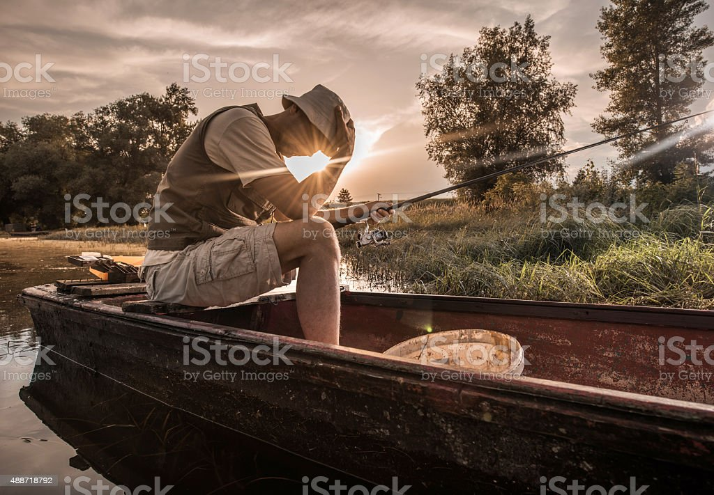 Depressed fisherman failed to catch a fish on fishing. stock photo