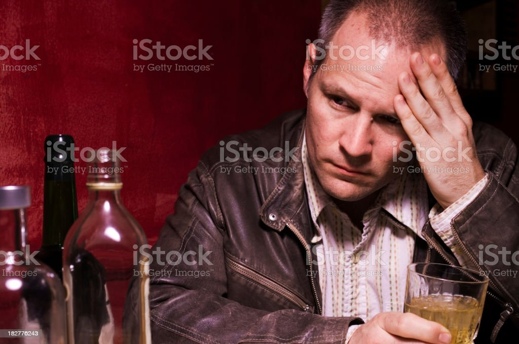 Depressed Forty Year Old Man Drinking Alone stock photo