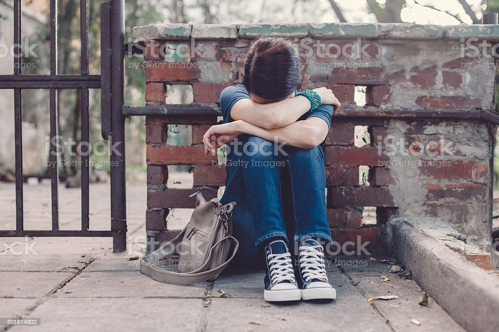 Depressed girl at the street stock photo