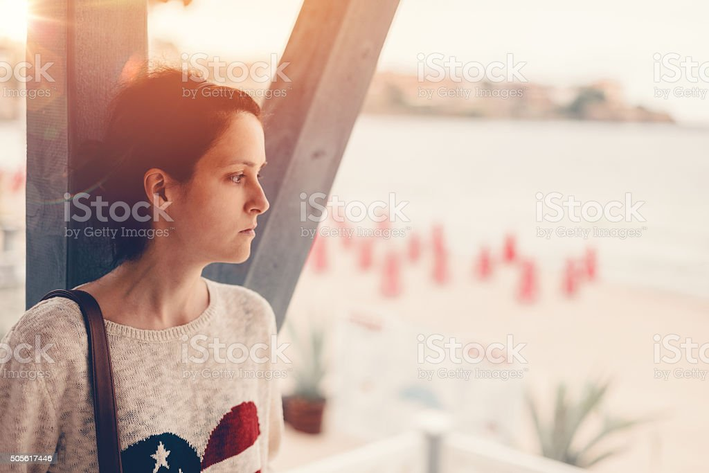 Depressed girl at the veranda stock photo