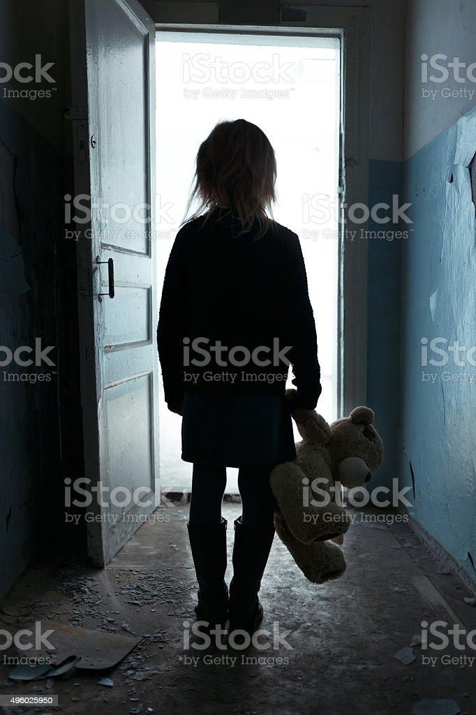 Depressed girl leaving the room stock photo