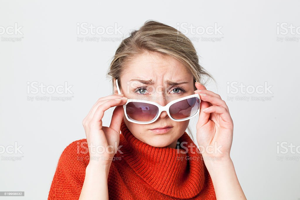 depressed girl looking over big sunglasses suffering from winter blues stock photo