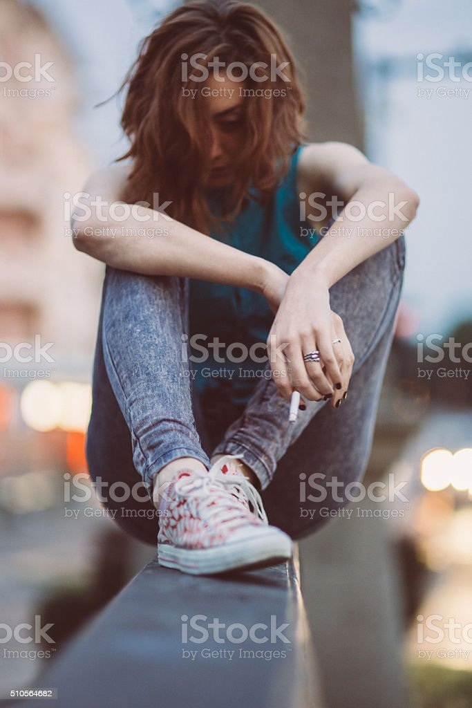 Depressed girl with cigarette stock photo