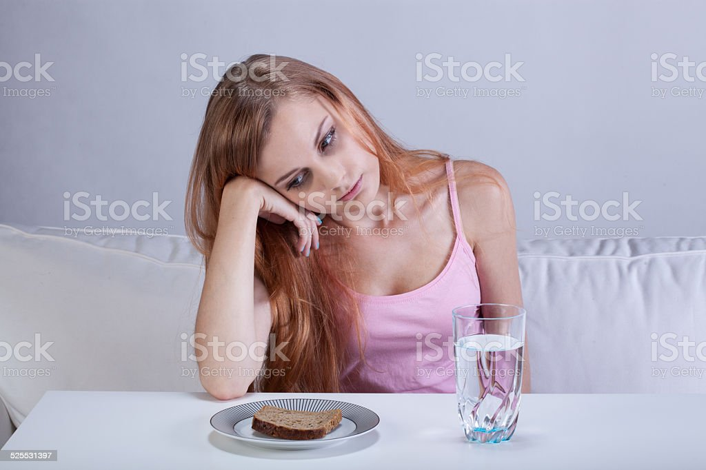Depressed girl with eating disorder stock photo