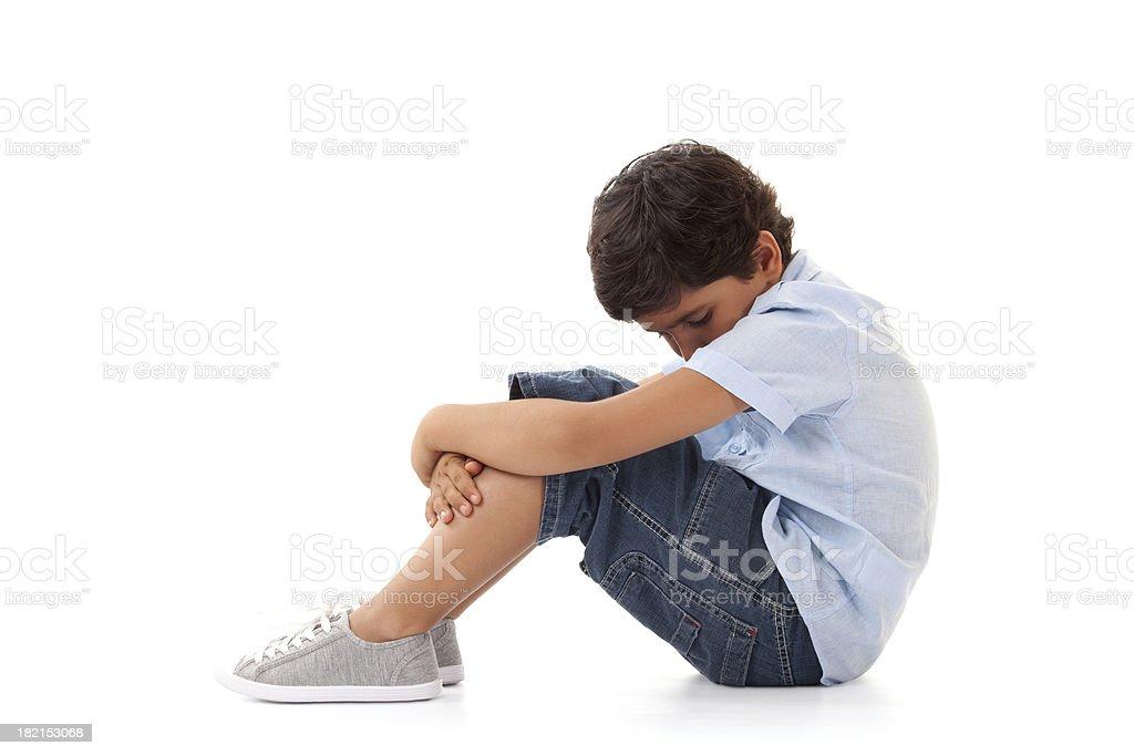 Depressed little boy stock photo