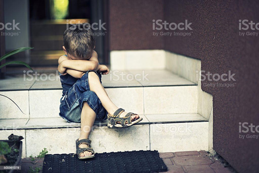 Depressed little boy stock photo