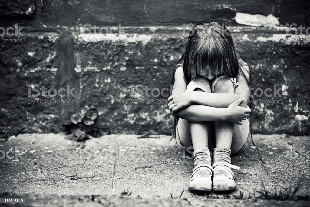 Depressed little girl stock photo