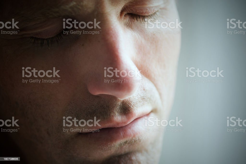 Depressed Man Crying with Eyes Closed Face Close Up stock photo