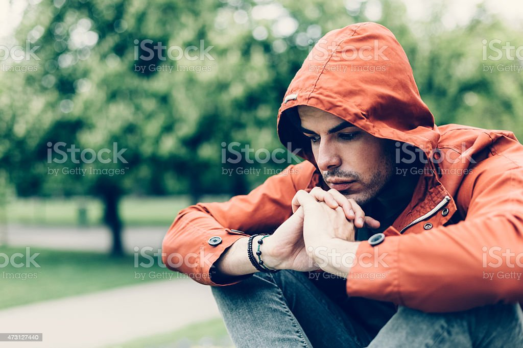 Depressed man in the park stock photo