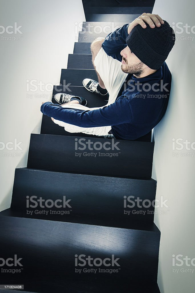Depressed man sitting on the stairs royalty-free stock photo