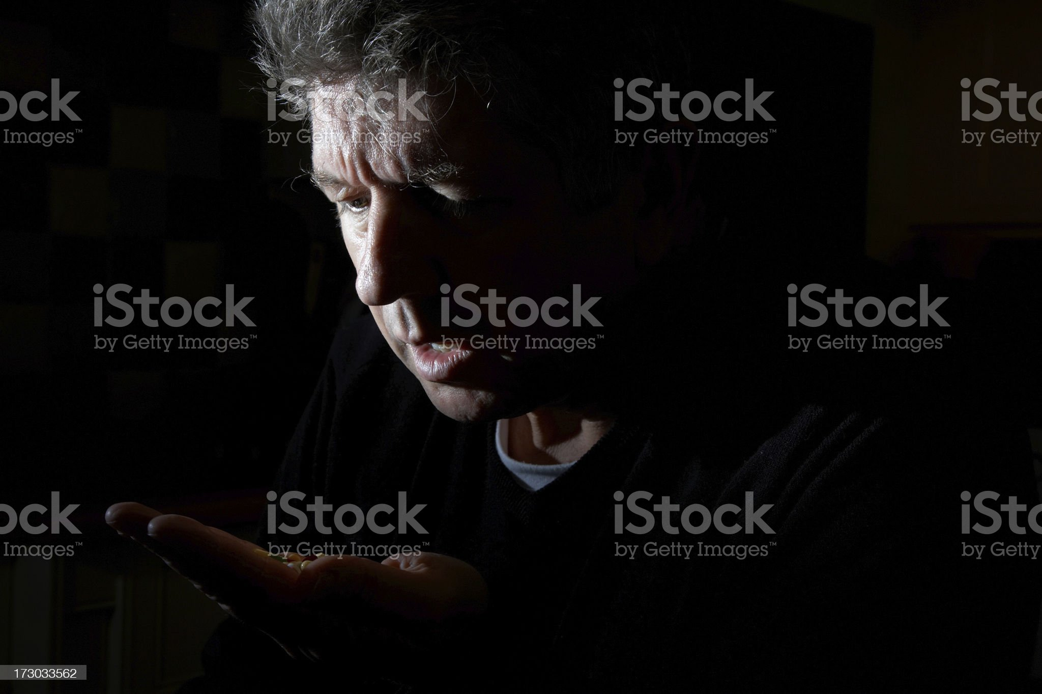 Depressed man taking tablets royalty-free stock photo