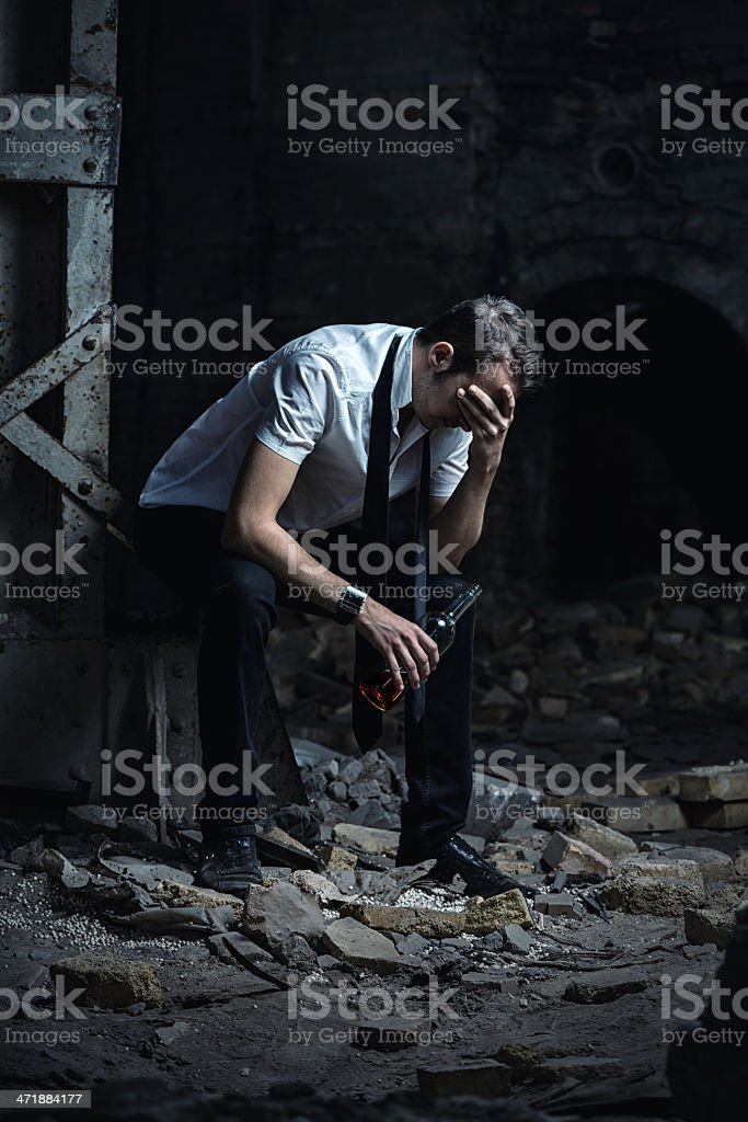depressed man with a bottle of wine royalty-free stock photo