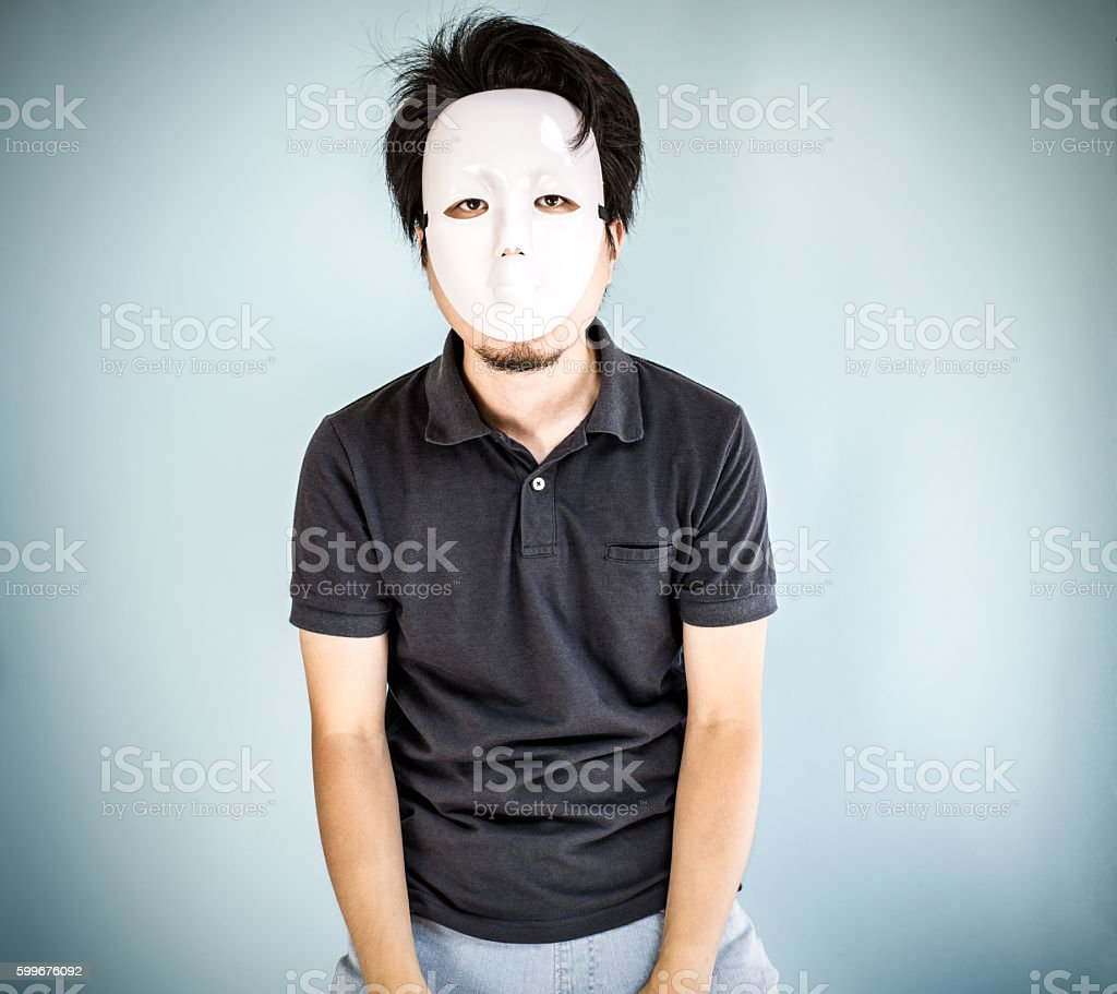 Depressed man with a mask stock photo