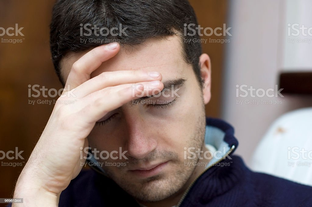 Depressed man with strong headache stock photo