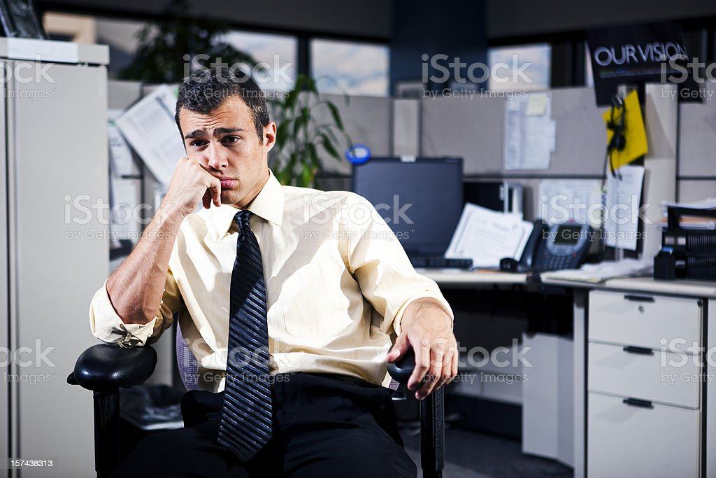 Depressed man working in the office stock photo