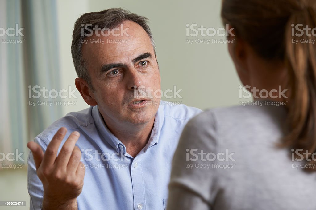 Depressed Mature Man Talking To Counsellor stock photo