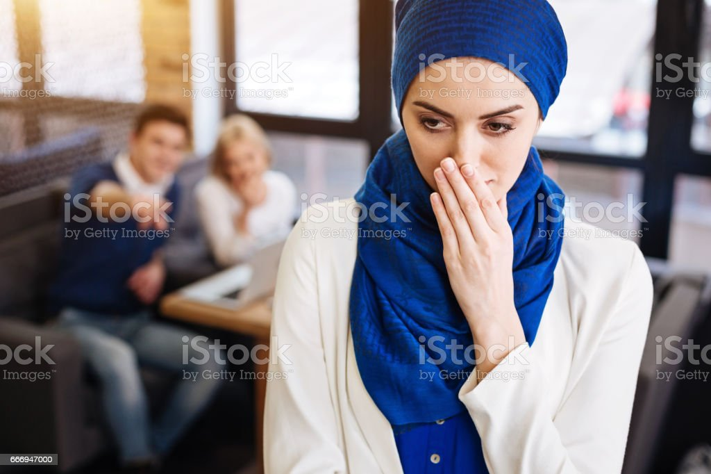 Depressed muslim woman feeling humiliated stock photo