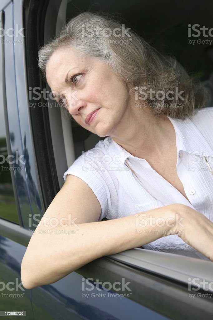 Depressed Senior Adult Woman Waiting in Her Car royalty-free stock photo