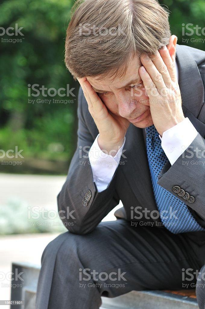 Depressed senior business man portrait royalty-free stock photo