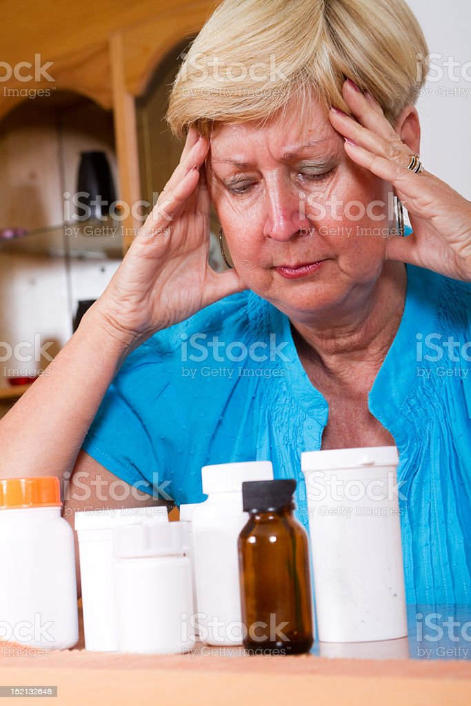 depressed senior woman with health problem royalty-free stock photo