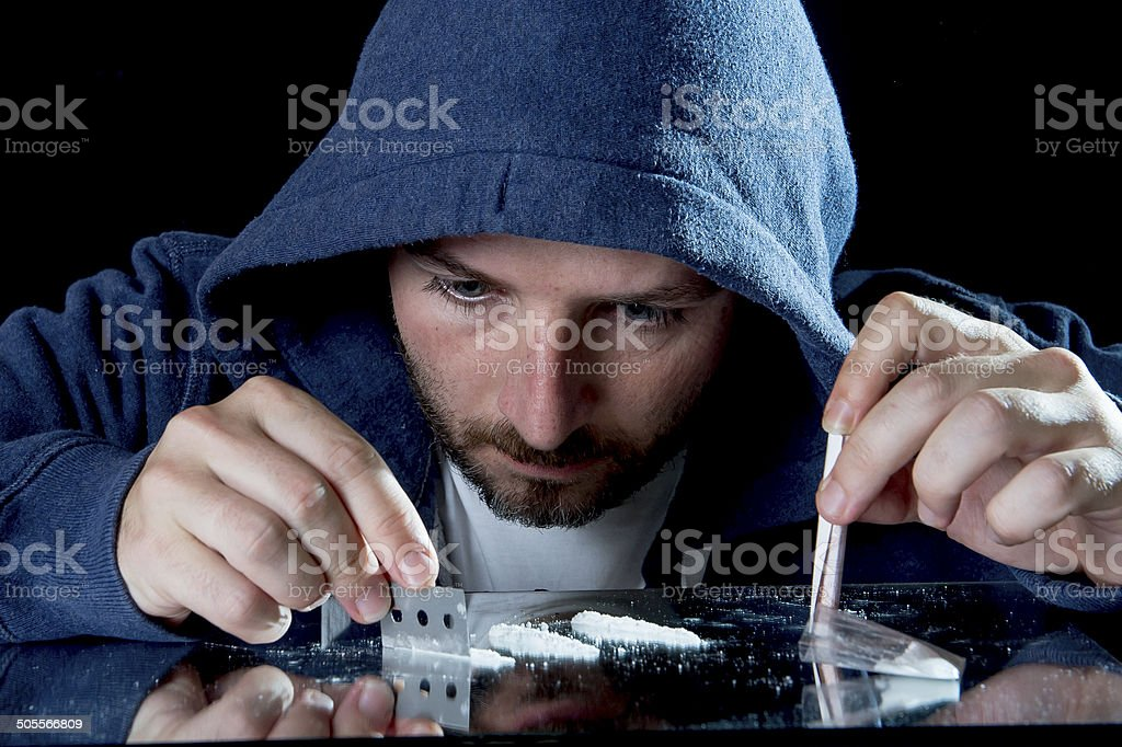 depressed sick looking Cocaine addict man sniffing coke stock photo