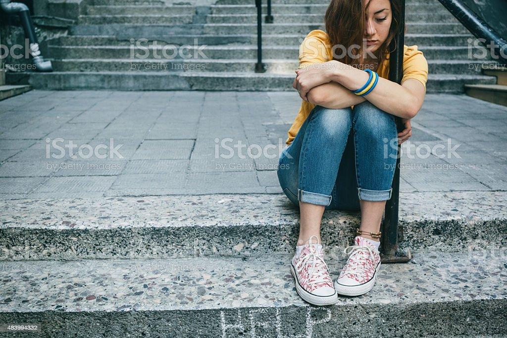 Depressed teen girl stock photo
