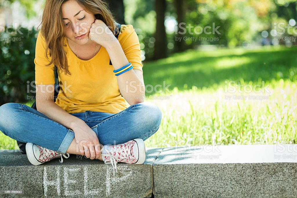 Depressed teen girl stock photo