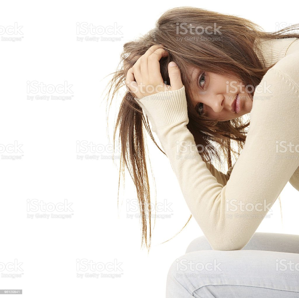 Depressed teenage girl holding her head as her hair falls royalty-free stock photo