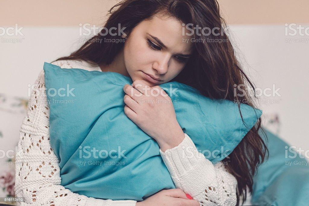 Depressed teenage girl in bed stock photo