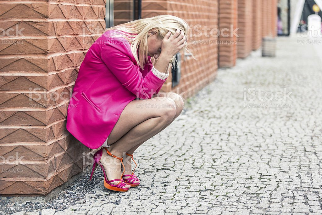 Depressed Woman Against Wall in the City royalty-free stock photo