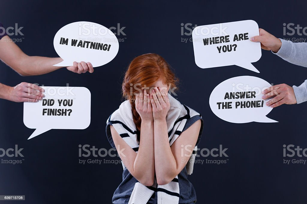 Depressed woman and word balloons stock photo