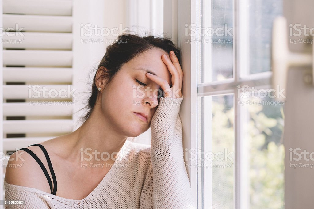 Depressed woman at home stock photo